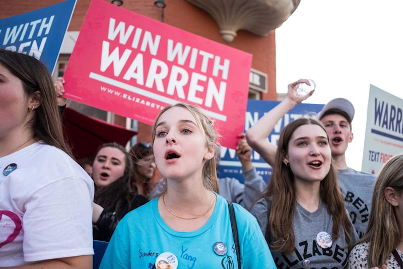 WESTERVILLE, UNITED STATES - 2019/10/15: Protesters shout slogans while holding placards during the democratic debate in support of Elizabeth Warren in Westerville. (Photo by Megan Jelinger/SOPA Images/LightRocket via Getty Images)