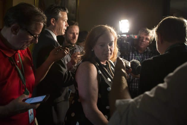 Ontario Minister of Children, Community and Social Services Lisa MacLeod turns away after scrumming with reporters at the Ontario Legislature, in Toronto on July 5, 2018.