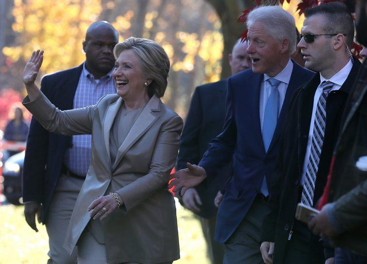 Democratic presidential nominee Hillary Clinton and her husband former U.S. President Bill Clinton greet supporters after voting at Douglas Grafflin Elementary School on November 8, 2016 in Chappaqua, New York.