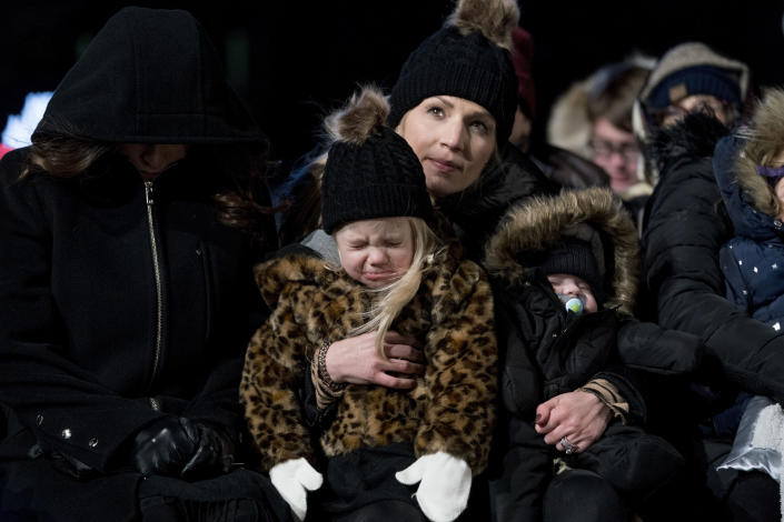 A girl cries in the cold temperature during the National Christmas Tree lighting ceremony at the Ellipse near the White House in Washington on Wednesday. (Photo: Andrew Harnik/AP)