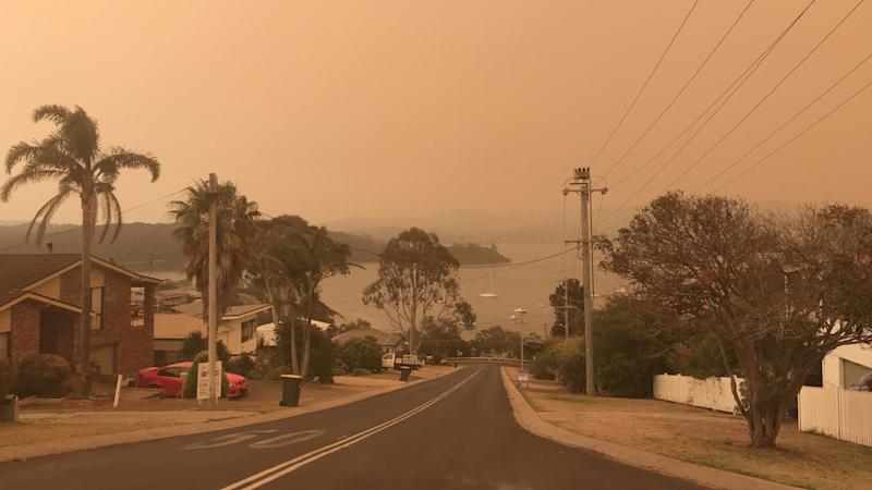 The Narooma sky has turned orange and hundreds of people have fled to an evacuation centre