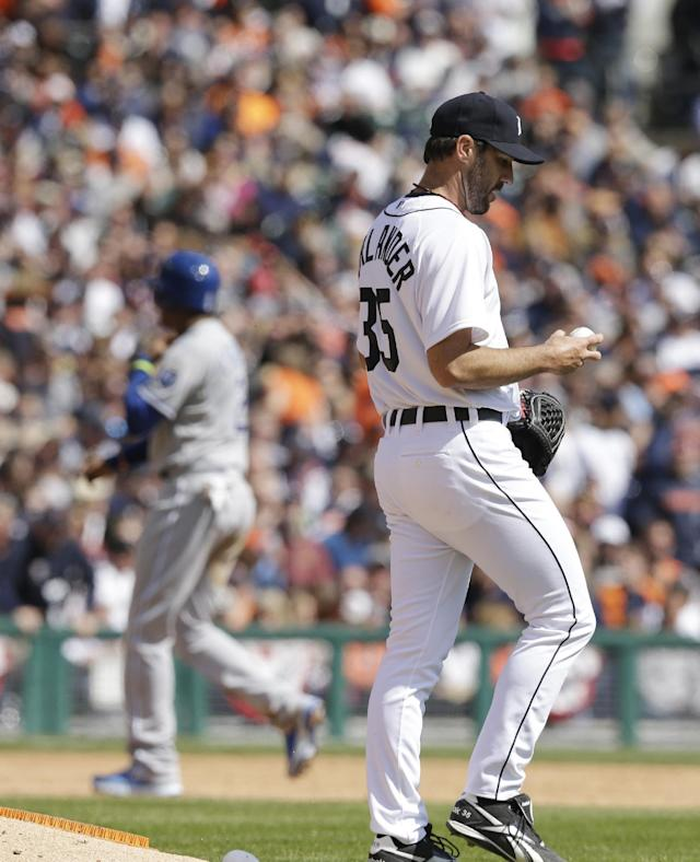 Kansas City Royals' Alcides Escobar advances to third as Detroit Tigers starting pitcher Justin Verlander fills the bases on a walk during the fourth inning of a baseball game in Detroit, Monday, March 31, 2014. (AP Photo/Carlos Osorio)