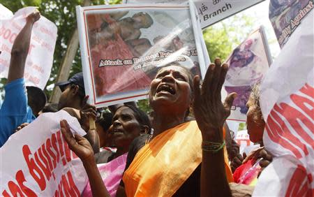 "A mother from the ""Dead and Missing Person's Parents Front"" organization cries as she shouts slogans during a protest against U.N. High Commissioner for Human Rights Navi Pillay's visit in front of the U.N. headquarters in Colombo August 30, 2013. REUTERS/Stringer"