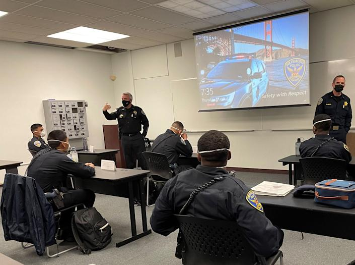"""Lt. Michael Nevin (gesturing at left) is shown here in a training session for San Francisco Police Department officers. """"No-news incidents are the great-news incidents,"""" says Nevin, whose officers take numerous training sessions aimed at making use of force a last-resort option."""
