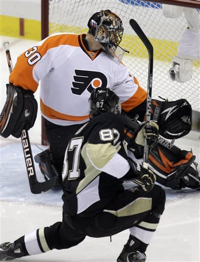 Pittsburgh Penguins' Sidney Crosby (87) fires a first-period goal past Philadelphia Flyers goalie IIya Bryzgalov (30) during Game 2 of an opening-round NHL hockey playoff series in Pittsburgh, Friday, April 13, 2012. (AP Photo/Gene J. Puskar)