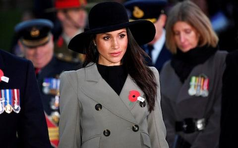 Meghan Markle wore a poppy at the Anzac Day service - Credit: Toby Melville/Getty