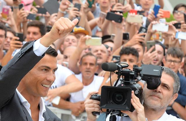 Cristiano Ronaldo gestures as he arrives at the Juventus' medical center in Turin, Italy July 16, 2018. REUTERS/Massimo Pinca