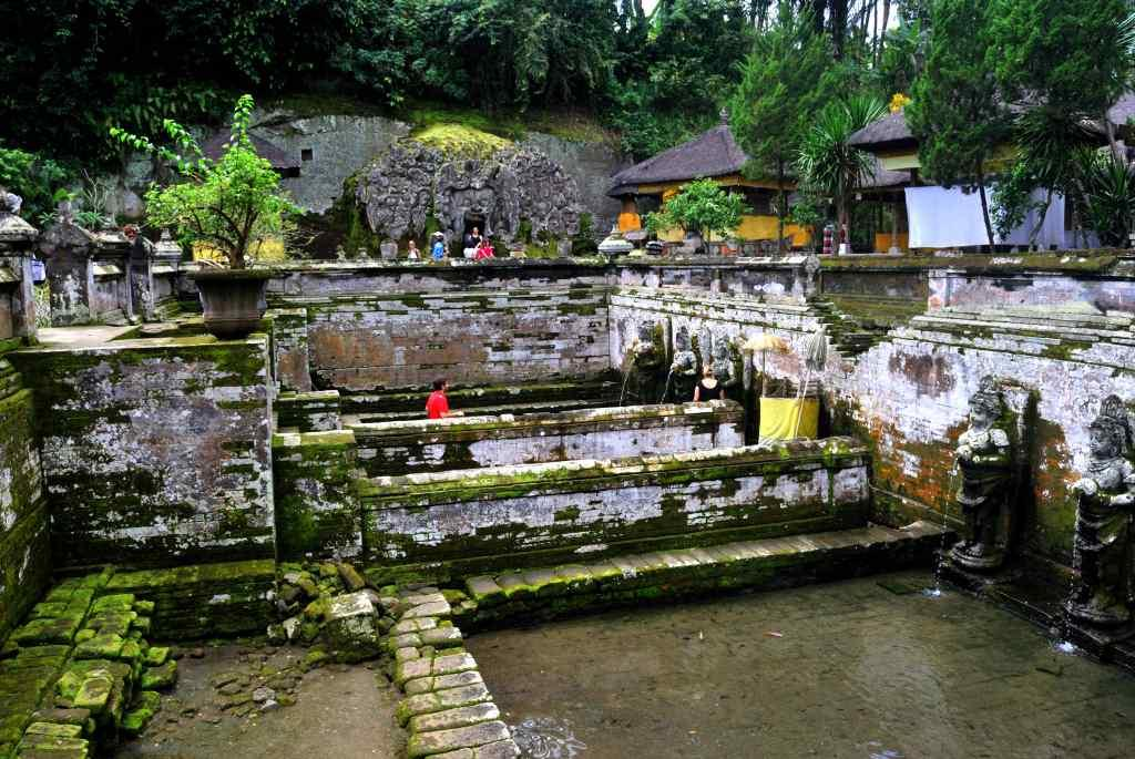 <b>The stepwell at the Goa Gajah Temple in Bali, Indonesia</b> <br><br> Carved images of the Buddha and smaller shrines and a step-well dot the green landscape of this 11th century site, called Lwa Gajah, which was not discovered until the 1950s. This Hindu temple was believed to be the sanctuary of a Buddhist monk.