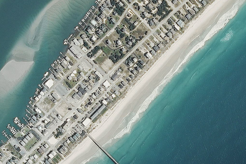 A 2014 aerial image shows larger beaches (National Oceanic and Atmospheric Administration)