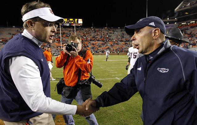 Auburn head coach Gus Malzahn, left, shakes hands with Florida Atlantic head coach Carl Pelini after defeating them 45-10 in an NCAA college football game on Saturday, Oct. 26, 2013, in Auburn, Ala. (AP Photo/Butch Dill)