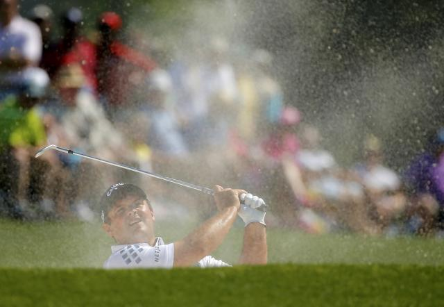 Patrick Reed of the U.S. hits from the sand trap on the 18th hole during the first round of the 2014 Masters golf tournament at the Augusta National Golf Club in Augusta, Georgia April 10, 2014. REUTERS/Brian Snyder (UNITED STATES - Tags: SPORT GOLF)