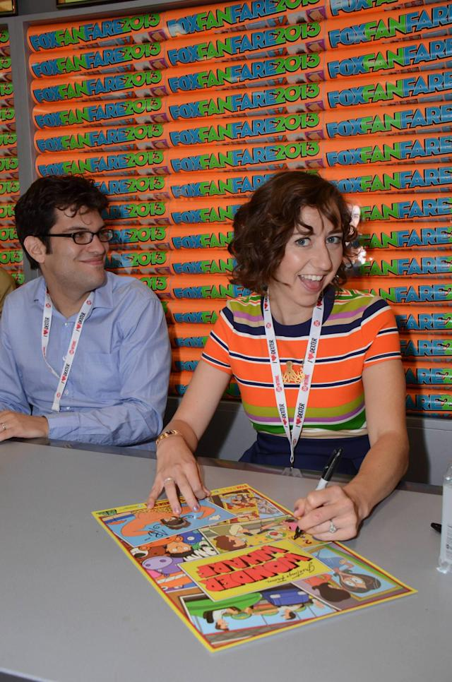 "Kristen Schaal signs an exclusive limited edition ""Bob's Burgers"" poster for fans on Friday, July 19 during Fox Fanfare At San Diego Comic-Con 2013."