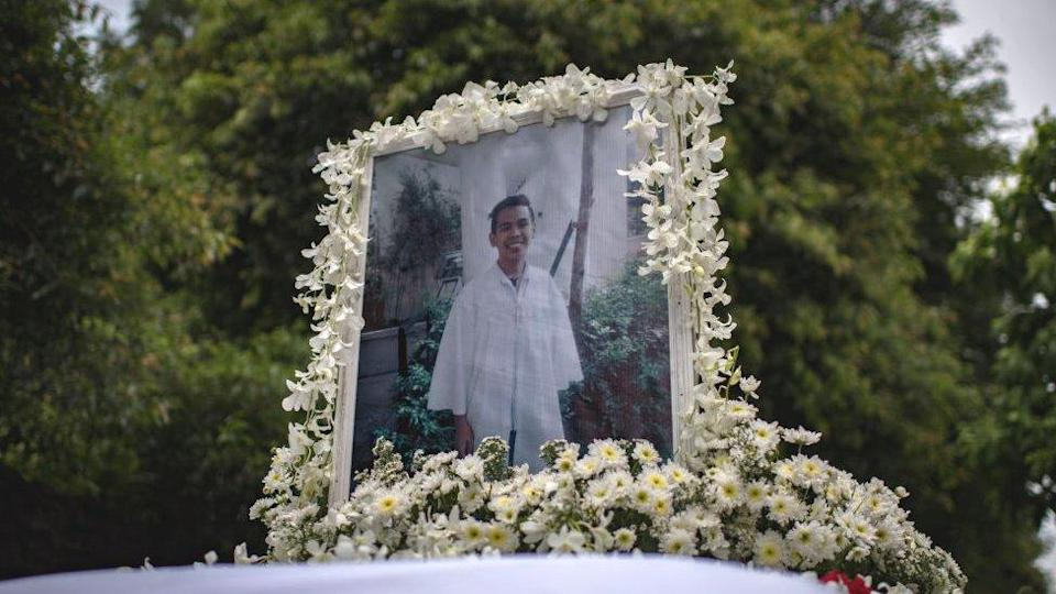 A photo of Kian Delos Santos, 17, on top of the hearse during his funeral on August 26, 2017