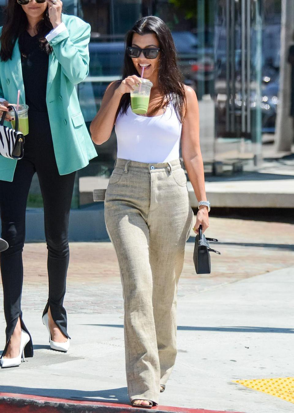 """<p>One of Kourtney's favorite breakfasts is her on-the-go avocado smoothie, which is made with honey and coconut milk. The full recipe is on <a href=""""https://poosh.com/how-to-make-an-avocado-shake/"""" rel=""""nofollow noopener"""" target=""""_blank"""" data-ylk=""""slk:Poosh"""" class=""""link rapid-noclick-resp"""">Poosh</a>. </p>"""