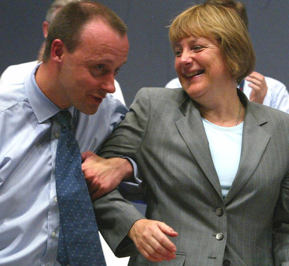 A 2002 file photo shows Merz former parliamentary floor leader of the conservative German Christian Democratic Union joking with CDU leader Angela Merkel after addressing the CDU party convention in Frankfurt.  Friedrich Merz (L), former parliamentary floor leader of the conservative German Christian Democratic Union (CDU) jokes with CDU leader Angela Merkel after addressing the CDU party convention in Frankfurt in this June 18, 2002 file photo. The main CDU finance spokesman Friedrich Merz is planning to step down from the party leadership board. REUTERS/Arnd Wiegmann/File Photo