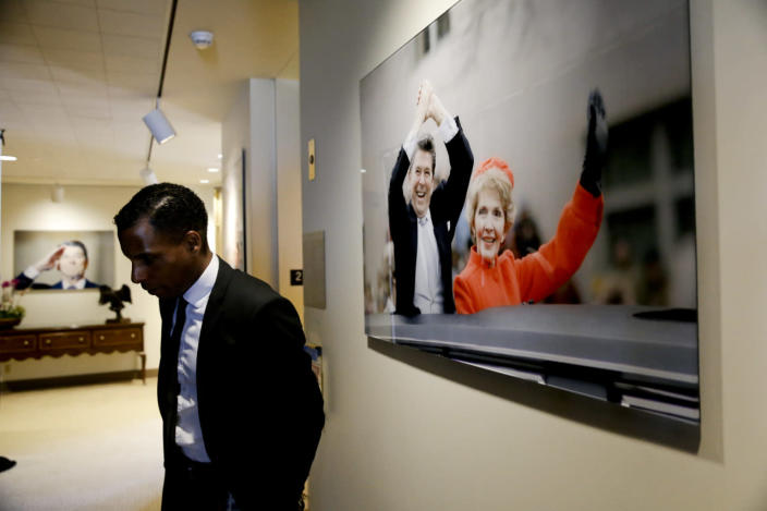 <p>Mark Fitzpatrick, director of information services and projects at the Ronald Reagan Presidential Library, pauses near a photograph of Ronald and Nancy Reagan. <i>(Photo: Jae C. Hong/AP)</i></p>