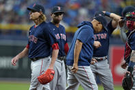 Boston Red Sox starting pitcher Garrett Richards, left, is taken out of the game by manager Alex Cora, center, during the second inning of a baseball game Wednesday, June 23, 2021, in St. Petersburg, Fla. (AP Photo/Chris O'Meara)