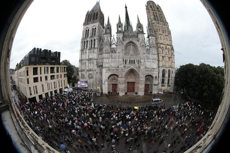 People stand outside Rouen cathedral during the funeral of Jacques Hamel on August 2, 2016