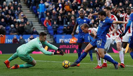 Soccer Football - Premier League - Leicester City vs Stoke City - King Power Stadium, Leicester, Britain - February 24, 2018 Leicester City's Matty James shoots at goal as Stoke City's Jack Butland attempts to save Action Images via Reuters/Andrew Boyers