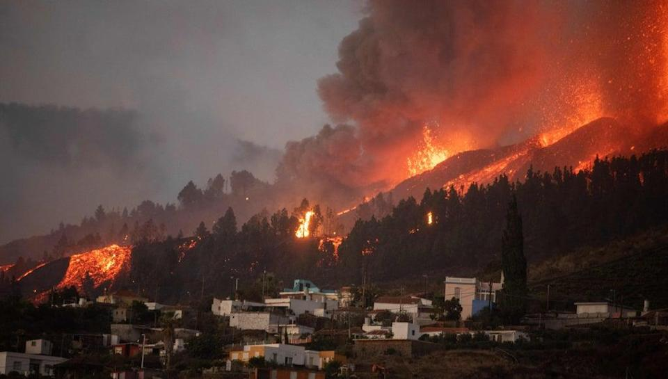 Mount Cumbre Vieja erupts in El Paso, spewing out columns of smoke, ash and lava as seen from Los Llanos de Aridane on the Canary island of La Palma (AFP via Getty Images)