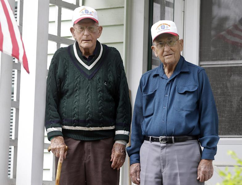 In this Wednesday, May 22, 2013 photo, World War II veterans Bob Addison, left, and Jerry West pose for a photo, in Glens Falls, N.Y. Addison and West share more than a longtime friendship. They share some of the same memories of bloody battles fought on Pacific islands while serving with an elite Marine Corps unit that was the forerunnner of today's U.S. Special Forces. Living just miles apart, the two men are among the last surviving members of the original Marine Raider battalions that were the first American ground troops to attack Japanese-held territory. (AP Photo/Mike Groll)