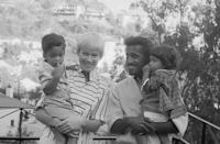 """<p>Sammy Davis Jr. and his wife, May Britt, expanded their family in the Rat Pack member's former bachelor pad. Sammy bought the Hollywood Hills home, <a href=""""https://www.architecturaldigest.com/story/home-owned-by-both-judy-garland-and-sammy-davis-jr"""" rel=""""nofollow noopener"""" target=""""_blank"""" data-ylk=""""slk:which was once owned by Judy Garland and Vincente Minnelli"""" class=""""link rapid-noclick-resp"""">which was once owned by Judy Garland and Vincente Minnelli</a>, in 1955. The entertainer made several changes to the home over the years, including adding a swimming pool, a pool house, and landscaping for privacy. </p>"""