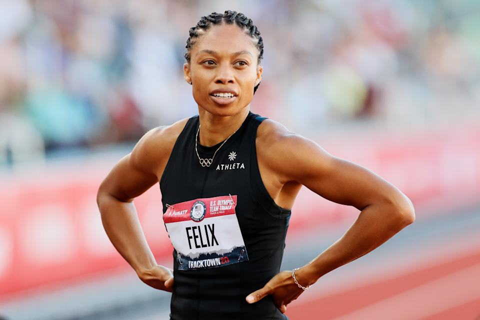 Allyson Felix's newest line with Athleta includes tanks, tights shorts and a crossbody sling. (Photo by Steph Chambers/Getty Images)