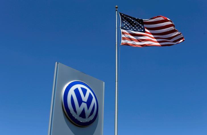FILE PHOTO - A U.S. flag flutters in the wind above a Volkswagen dealership in Carlsbad