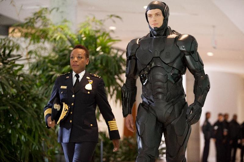 """This image released by Columbia Pictures shows Marianne Jean-Baptiste, left, and Joel Kinnaman in a scene from """"RoboCop."""" (AP Photo/Columbia Pictures - Sony, Kerry Hayes)"""