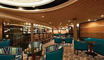 <p>The Silver Cloud's bar room features complimentary cocktails, live music and a dance floor. (silversea.com) </p>