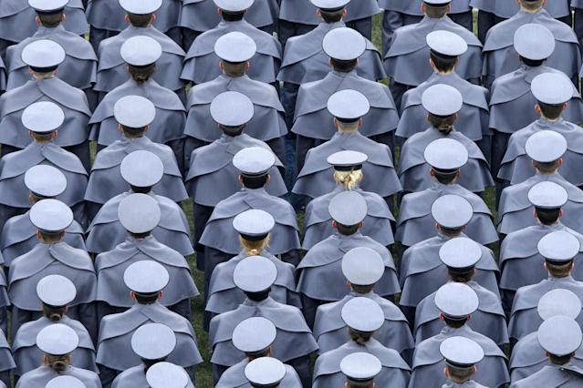 Army cadets march onto the field before an NCAA college football game against the Navy, Saturday, Dec. 14, 2013, in Philadelphia. (AP Photo/Matt Rourke)