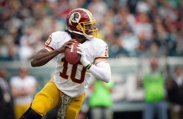 Washington Redskins quarterback Robert Griffin III looks to pass against the Philadelphia Eagles during the first half of an NFL football game in Philadelphia, Sunday, Nov. 17, 2013. (AP Photo/The News-Journal, Andre L. Smith)