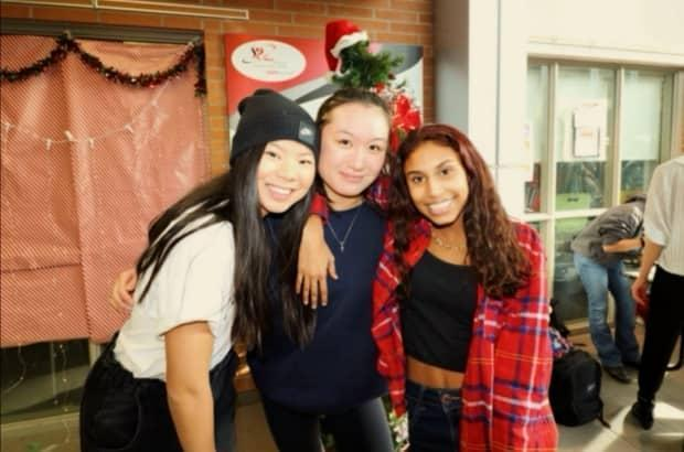 High school grad Charis Liu, centre, feels 'socially deprived' by the pandemic. Normally, she should have been planning to go to the prom, hanging out with friends and cheering on her school's sports teams.