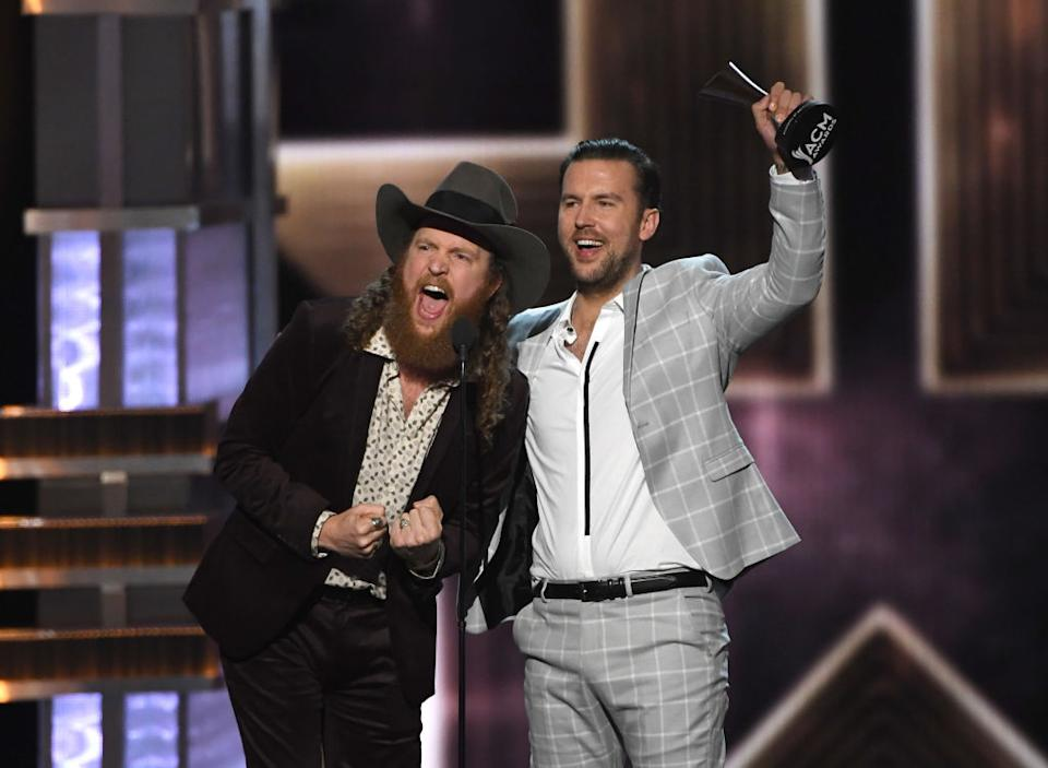 John and T.J. Osborne, of Brothers Osborne, accept the Vocal Duo of the Year award, during the 52nd Academy of Country Music Awards on April 2, 2017. (Photo: Ethan Miller/Getty Images)