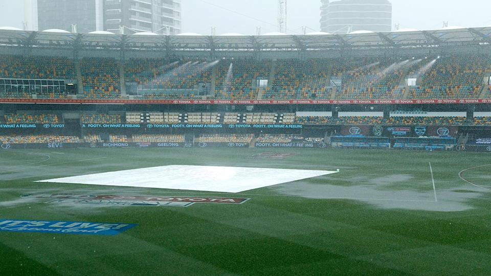 Torrential rain, pictured here lashing the Gabba before the AFL grand final.