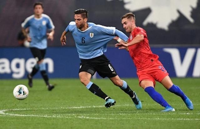 Uruguay midfielder Rodrigo Bentancur battles with the United States' Tyler Boyd during the two teams' 1-1 draw on Tuesday (AFP Photo/Tim Vizer)