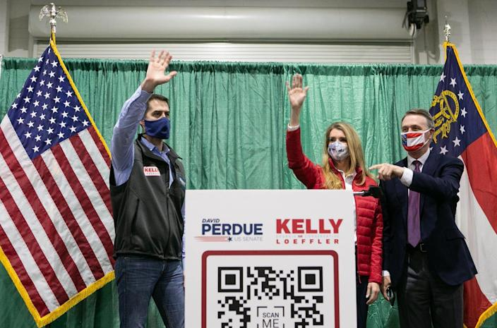 """<span class=""""caption"""">(R to L) Georgia GOP Sens. David Purdue and Kelly Loeffler at a rally with Sen. Tom Cotton on Nov. 19, 2020 in Perry, Ga. Loeffler and Purdue face runoff elections against Democratic Senate candidates Jon Ossoff and Raphael Warnock on Jan. 5, 2021. </span> <span class=""""attribution""""><a class=""""link rapid-noclick-resp"""" href=""""https://www.gettyimages.com/detail/news-photo/sen-david-purdue-and-sen-kelly-loeffler-wave-to-the-crowd-news-photo/1229686396?adppopup=true"""" rel=""""nofollow noopener"""" target=""""_blank"""" data-ylk=""""slk:Jessica McGowan/Getty Images"""">Jessica McGowan/Getty Images</a></span>"""