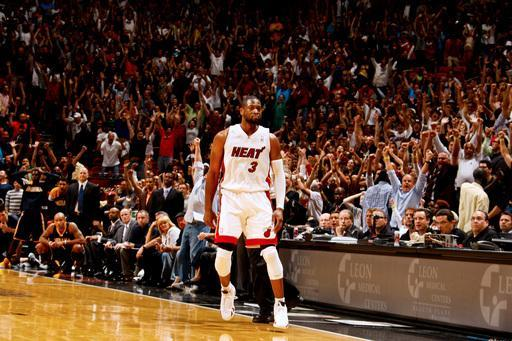 MIAMI, FL - MARCH 10: Dwyane Wade #3 of the Miami Heat reacts after hitting the winning shot in overtime against the Indiana Pacers on March 10, 2012 at American Airlines Arena in Miami, Florida. (Photo by Issac Baldizon/NBAE via Getty Images)