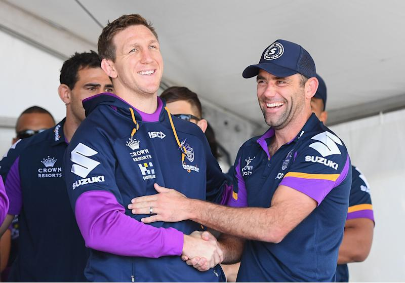 Ryan Hoffman and Cameron Smith have a laugh during the Melbourne Storm Fan Day.