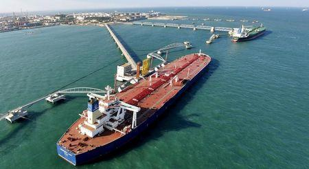 FILE PHOTO - A general view of a crude oil importing port in Qingdao