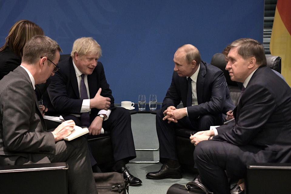 BERLIN, GERMANY - JANUARY 19, 2020: UK Prime Minister Boris Johnson and Russia's President Vladimir Putin (C L-R) talk during a meeting on the sidelines of an international summit on Libya; the summit is to discuss efforts to achieve peace and reconciliation between Libya's government and General Haftar; right: the Russian president's adviser Yuri Ushakov. Alexei Nikolsky/Russian Presidential Press and Information Office/TASS (Photo by Alexei Nikolsky\TASS via Getty Images)