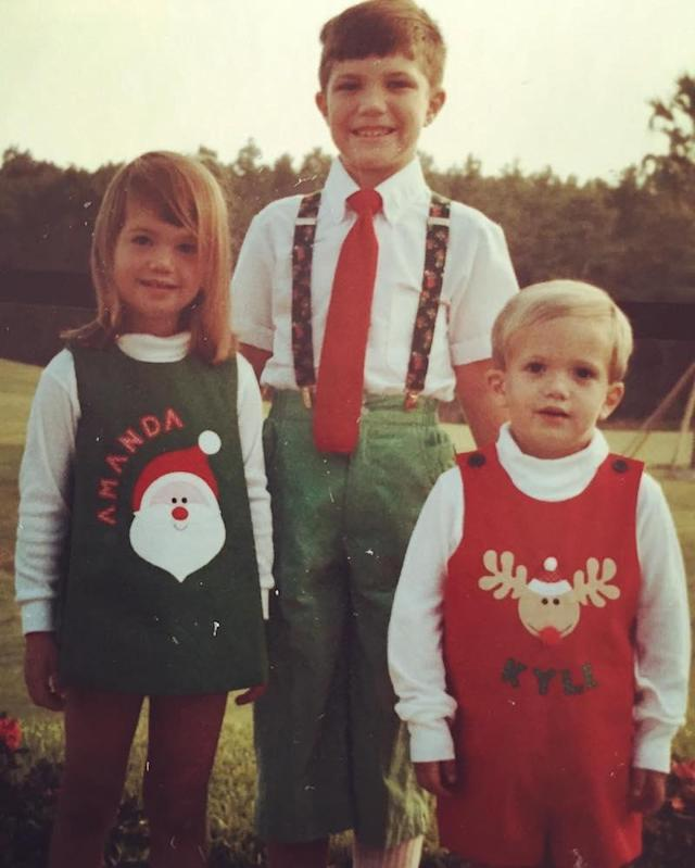"<p>""To simpler times and shorter hemlines,"" Mandy joked about this classic Christmas pic with her brothers, Scott and, well, as you can see in the photo, Kyle. (Photo: Mandy Moore via <a href=""https://www.instagram.com/p/BNxRZcNgYv2/?taken-by=mandymooremm&hl=en"" rel=""nofollow noopener"" target=""_blank"" data-ylk=""slk:Instagram"" class=""link rapid-noclick-resp"">Instagram</a>) </p>"