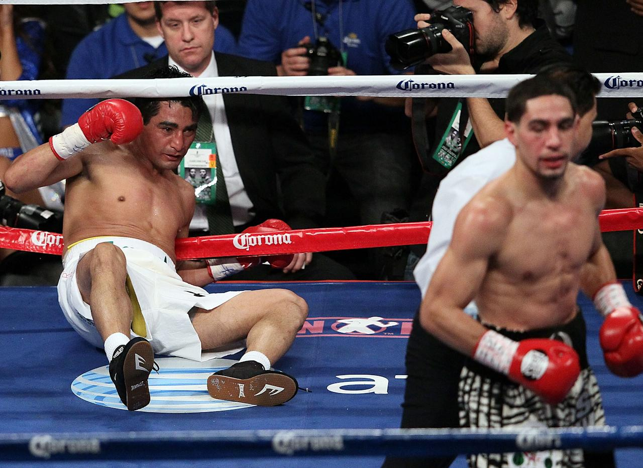 NEW YORK, NY - OCTOBER 20:  Erik Morales is knocked out by Danny Garcia in the fourth round of their WBA Super, WBC & Ring Magazine Super Lightweight title fight at the Barclays Center on October 20, 2012 in the Brooklyn borough of New York City.  (Photo by Alex Trautwig/Getty Images)