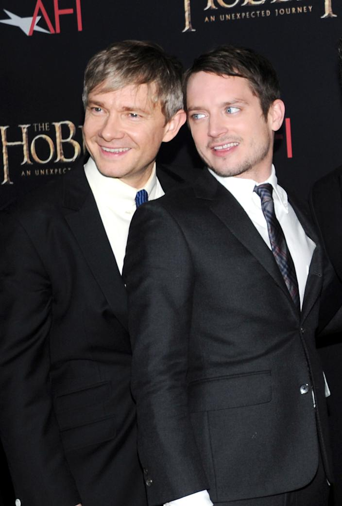 """Actors Martin Freeman, left, and Elijah Wood attend the premiere of """"The Hobbit: An Unexpected Journey"""" at the Ziegfeld Theatre on Thursday Dec. 6, 2012 in New York. (Photo by Evan Agostini/Invision/AP)"""