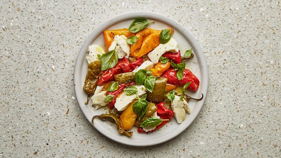 "The hands-off approach for this summery caprese recipe means no blistering the peppers on the stovetop and no need to peel them—although some of the skins will slide right off after cooking if you nudge them along. This recipe is part of the Healthyish Farmers' Market Challenge. Get all 10 recipes <a href=""https://www.bonappetit.com/farmersmarketchallenge?mbid=synd_yahoo_rss"" rel=""nofollow noopener"" target=""_blank"" data-ylk=""slk:here"" class=""link rapid-noclick-resp"">here</a>. <a href=""https://www.bonappetit.com/recipe/roasted-pepper-caprese?mbid=synd_yahoo_rss"" rel=""nofollow noopener"" target=""_blank"" data-ylk=""slk:See recipe."" class=""link rapid-noclick-resp"">See recipe.</a>"