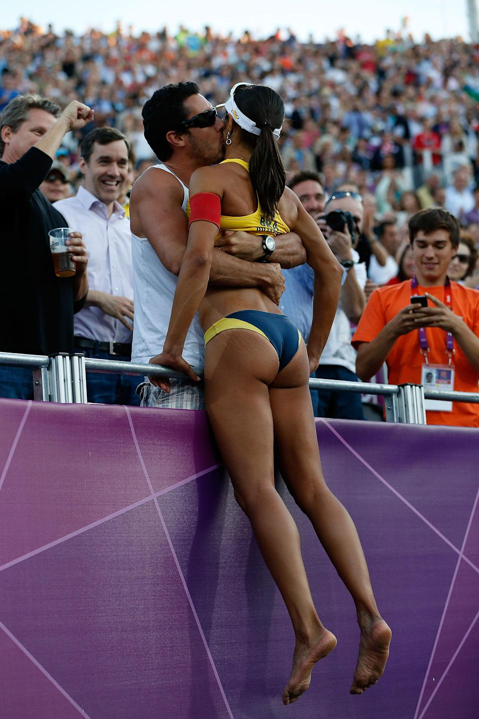 Juliana Silva of Brazil climbs into the crowd as she celebrates winning the Bronze medal in the Women's Beach Volleyball Bronze medal match against China on Day 12 of the London 2012 Olympic Games at the Horse Guard's Parade on August 8, 2012 in London, England. (Photo by Jamie Squire/Getty Images)