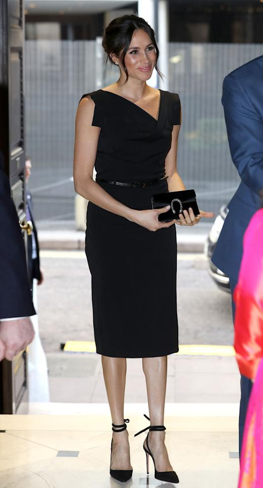 """<p>Markle wore the affordable classic black shift dress by Black Halo. The """"Jackie O."""" dress is inspired by former U.S. first lady, Jackie Kennedy Onassis. </p>"""