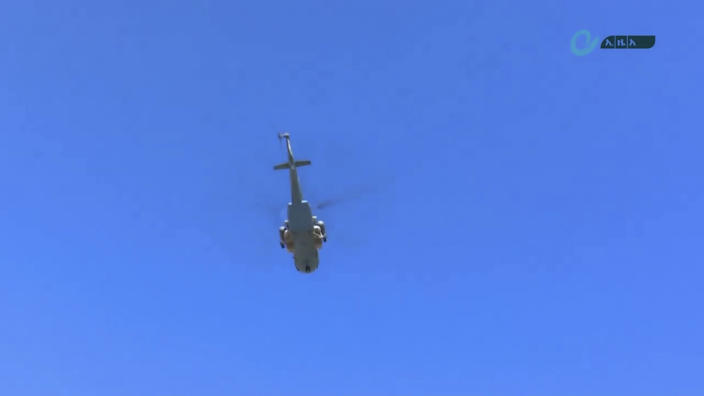 "This image made from undated video released by the state-owned Ethiopian News Agency on Monday, Nov. 16, 2020 shows a helicopter in the sky over an area near the border of the Tigray and Amhara regions of Ethiopia. Ethiopia's prime minister Abiy Ahmed said in a social media post on Tuesday, Nov. 17, 2020 that ""the final and crucial"" military operation will launch in the coming days against the government of the country's rebellious northern Tigray region. (Ethiopian News Agency via AP)"