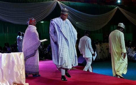 Nigerian President Muhammadu Buhari walks to the lectern to address the crowd gathered at an electoral commission ceremony in Abuja - Credit: AP