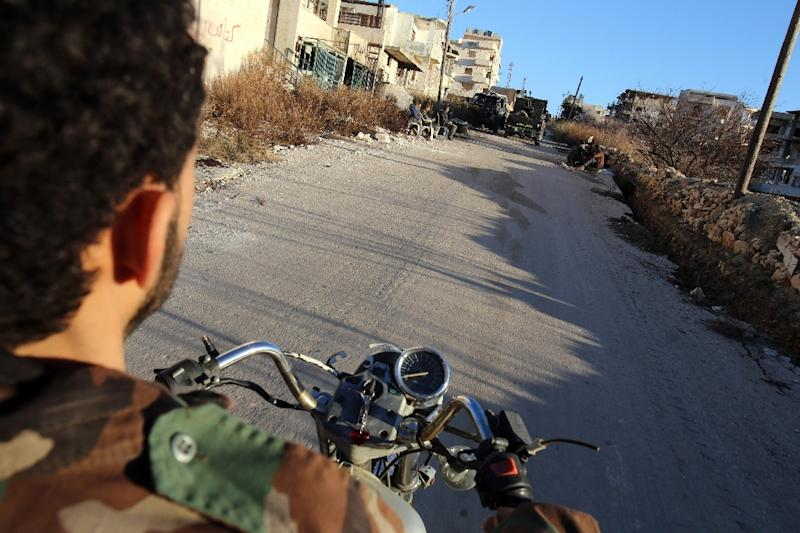 Syrian soldiers say motorbikes were key to the recapture of Salma, a town that was a rare rebel stronghold in the regime bastion of coastal Latakia province (AFP Photo/Youssef Karwashan)